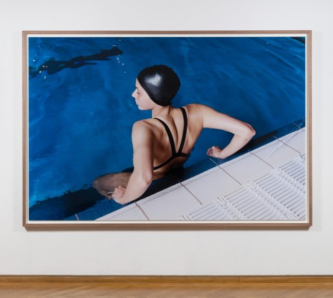 Coco Capitán, Swimmer at the Edge of the Pool, 2018, C-type Print, 69.6 x 106.6in. (177 x 270cm.)© Coco Capitán, image courtesy of Maximillian William