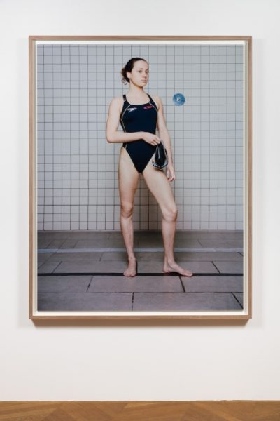 Coco Capitán, Swimmer with Cap in Hand, 2018, C-type Print, 70.8 x 55.1in. (180 x 140cm.)© Coco Capitán, image courtesy of Maximillian William